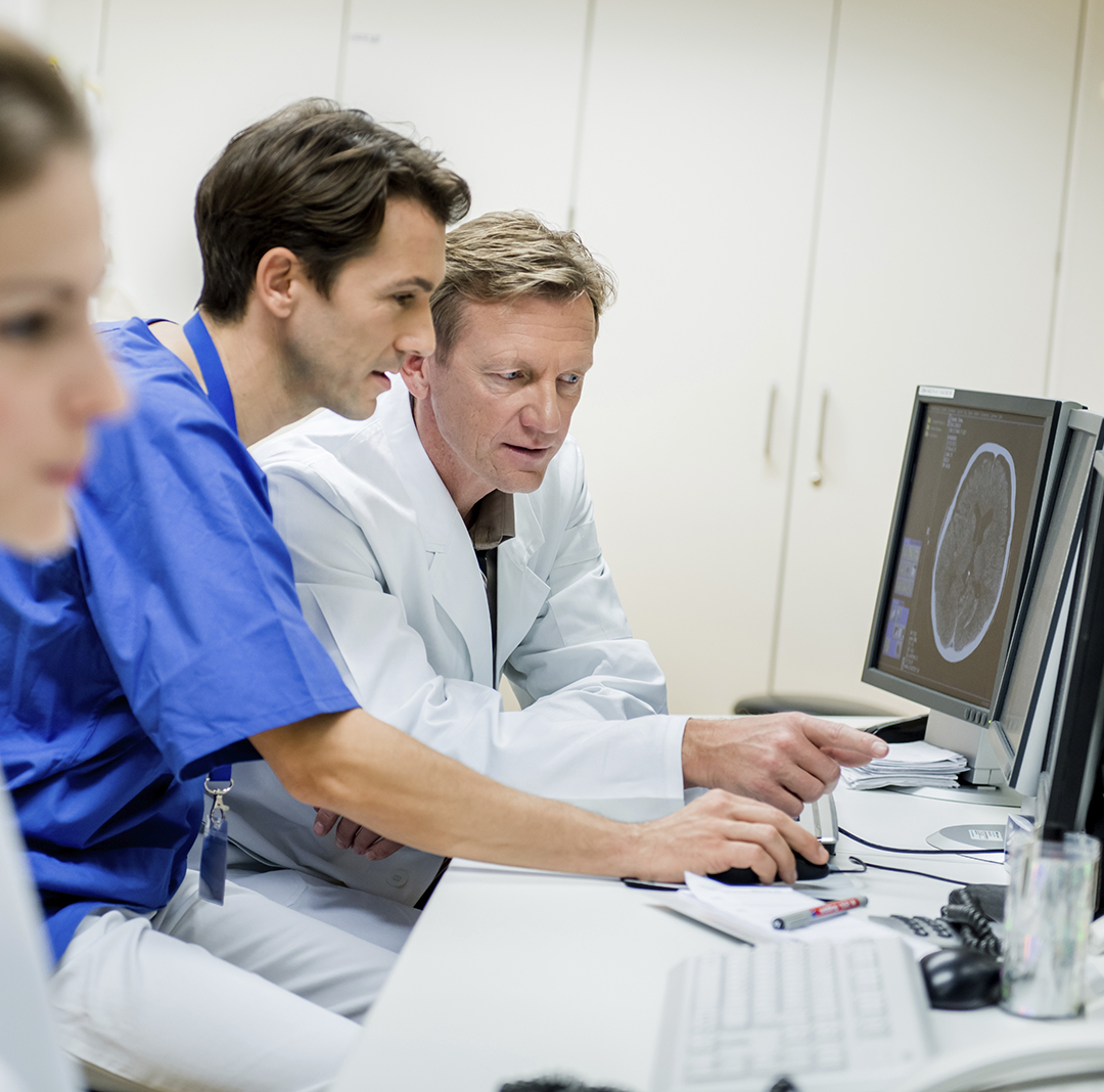 Doctors reviewing results from endoscopy